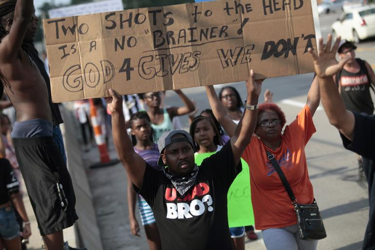 ferguson-protesters-hold-signs